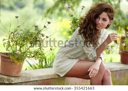 Beautiful woman resting in the summer the Italian garden