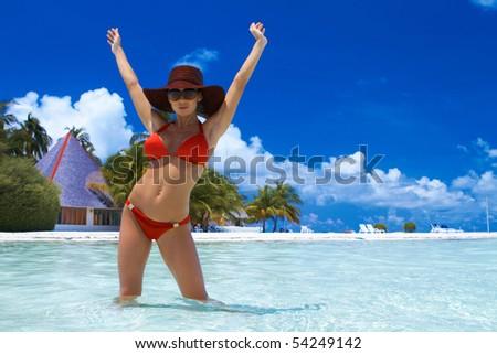 Beautiful woman resting in water at Maldives - stock photo