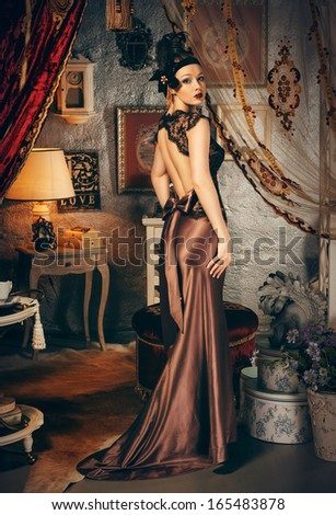 Beautiful woman retro style interior, full length