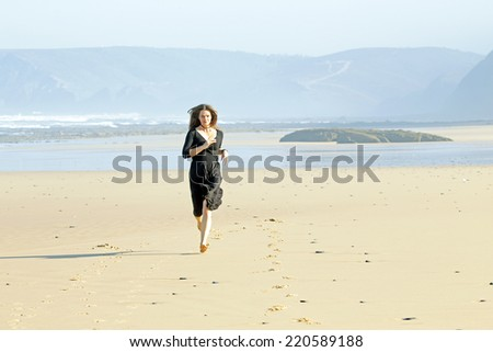 Beautiful woman running at the beach