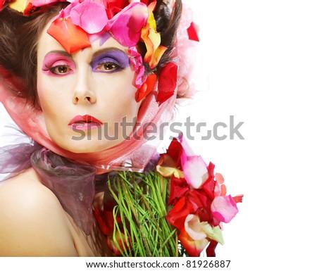 Beautiful Woman's Face and rose petals. Bride make-up. - stock photo