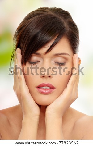 Beautiful woman's face with fresh clean skin - stock photo