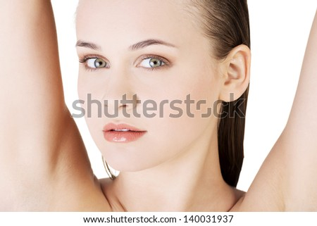 Beautiful woman's face with fresh clean skin - isolated on white background