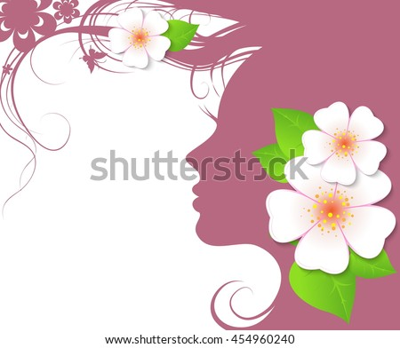 Beautiful woman's face with the flower in her hair. - stock photo
