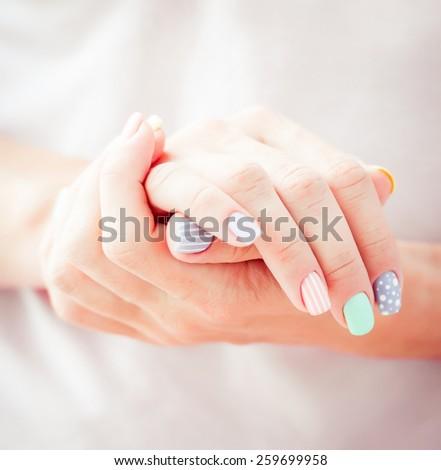 beautiful woman's hand  gray background - stock photo