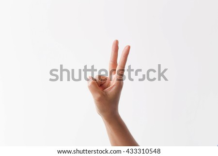 Beautiful woman's hand showing two count isolated on white background.  - stock photo