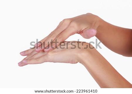 Beautiful woman's hands applying cream - stock photo