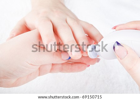 beautiful woman's hands are doing the male manicure - stock photo
