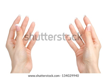 Beautiful woman's hands hold isolated on white background. - stock photo