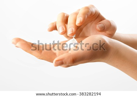 Beautiful woman's hands with  care cream on the palm.Skincare concept - stock photo