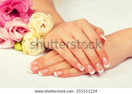 Beautiful woman's hands with french manicure