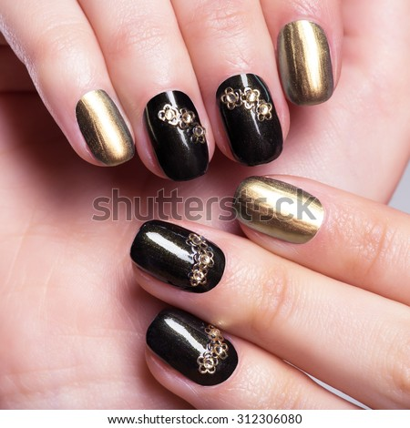 Beautiful woman's nails with beautiful creative manicure - stock photo