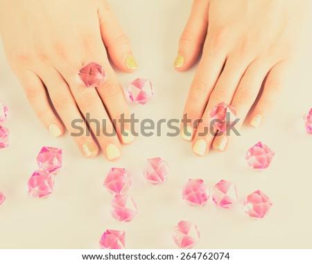 Beautiful woman's nails with beautiful manicure. studio shot - stock photo