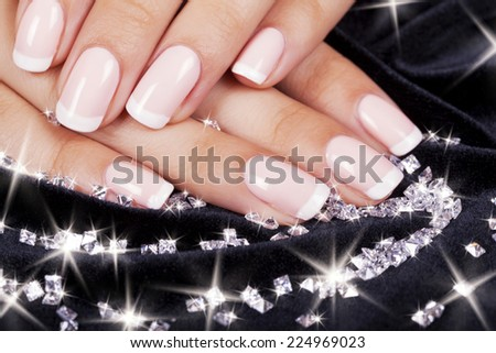 Beautiful Womans Nails With French Manicure And Diamonds
