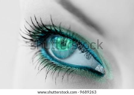 beautiful woman's open green eye - stock photo