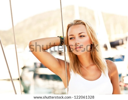 Beautiful woman sailing, young adult lady enjoying summer travel, close-up portrait on sexy female face, summer cruise holidays, European girl tourist traveling in sail boat around the world - stock photo