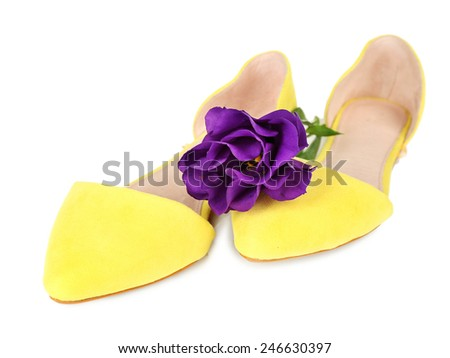 Beautiful woman shoes with flower isolated on white