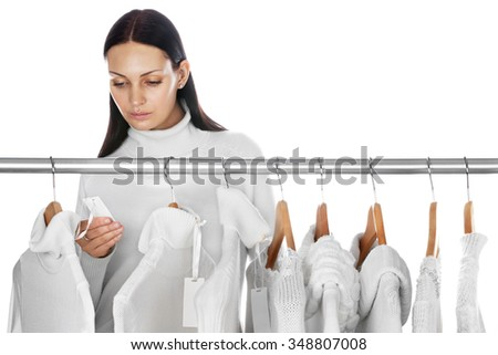 Beautiful woman shopping during winter sale season  - stock photo