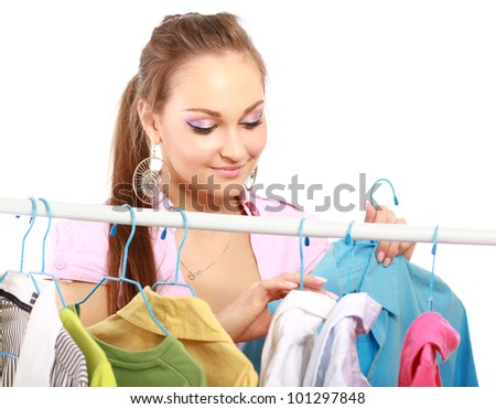 Beautiful woman shopping for some clothes at a store