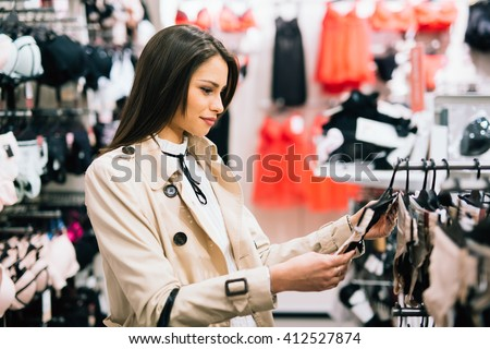 Beautiful woman shopping lingerie and underware - stock photo