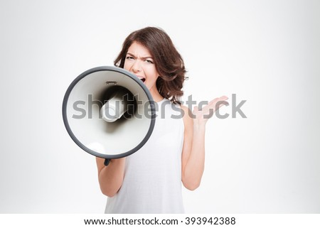 Beautiful woman shouting into megaphone isolated on a white background - stock photo