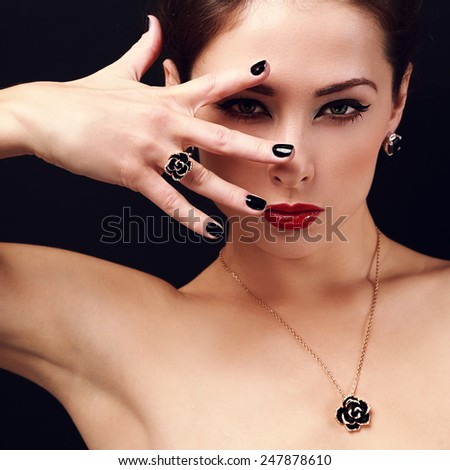 Beautiful woman showing hand with black nails gloss. Closeup portrait - stock photo