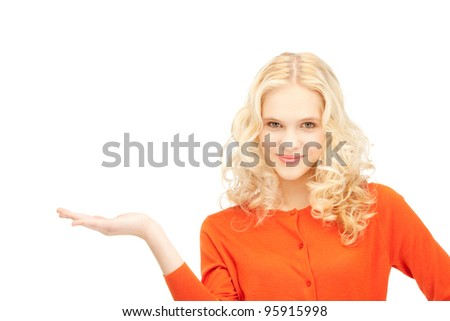 beautiful woman showing something on the palm of her hand - stock photo