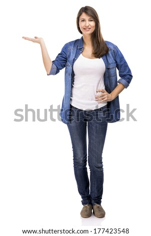 Beautiful woman showing something over a white background - stock photo
