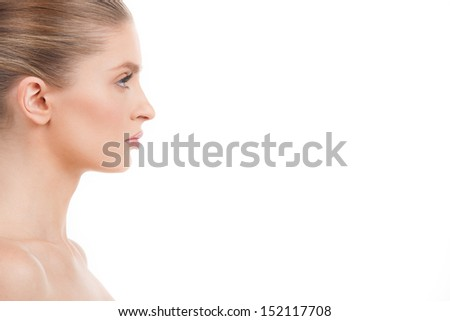 Beautiful woman. Side view of beautiful young woman looking away while isolated on white - stock photo