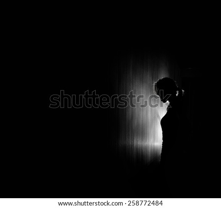 beautiful woman silhouette, black background. - stock photo