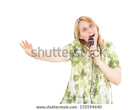 Beautiful woman singing and dancing - stock photo