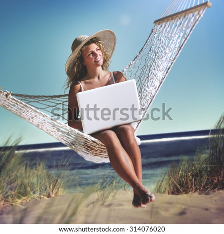 Beautiful Woman Sitting on a Hammock by the Beach Concept - stock photo