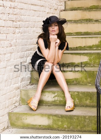 Beautiful woman sitting on stone staircase