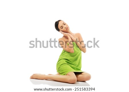 Beautiful woman sitting wrapped in towel.