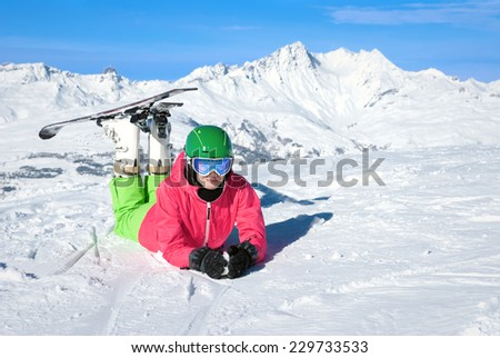 Beautiful woman skiing in the Alps