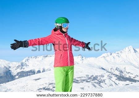 Beautiful woman skiing in the Alps - stock photo