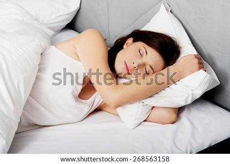 Beautiful woman sleeping in bed. - stock photo
