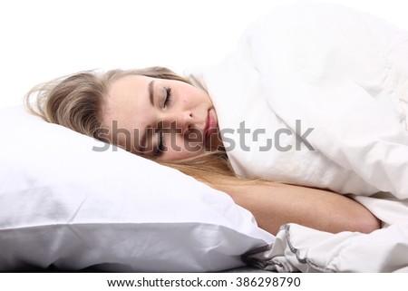 Beautiful woman sleeping in bed - stock photo