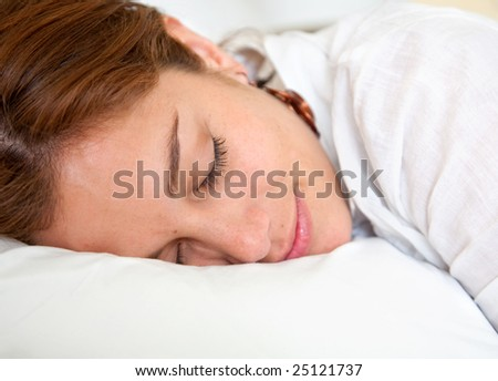 Beautiful woman sleeping over a white pillow