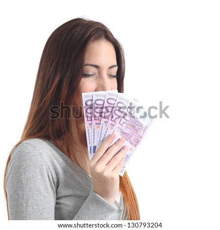 Beautiful woman smelling and holding and showing a lot of five hundred euro banknotes on a white isolated background