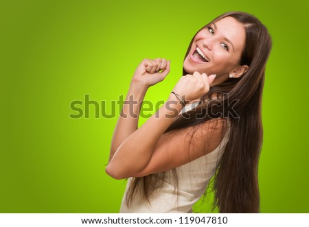 Beautiful woman smiling against a green background - stock photo