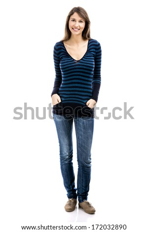 Beautiful woman smiling and standing over a white background - stock photo