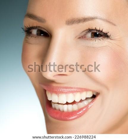 Beautiful woman smiling - close up. - stock photo