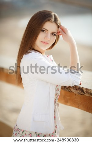 Beautiful woman smiling outdoor, carefree girl enjoying nature, happy woman spring portrait, happy woman at sunset beach, beauty young girl outdoors, series, soft light. - stock photo