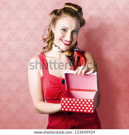Beautiful Woman Smiling With A Gift In The Shape Of Heart Box In Romantic Valentine's Day Concept - stock photo