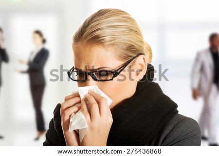 Beautiful woman sneezing because of flu. - stock photo