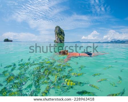 Beautiful woman snorkelling in Krabi Thailand  - stock photo