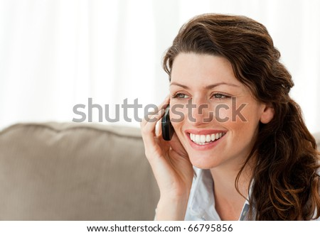 Beautiful woman speaking on the phone at home - stock photo