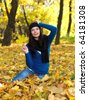 Beautiful woman spending time in park during autumn season - stock photo