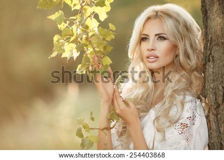 Beautiful woman Spring portrait outdoors smiling girl natural beauty, lovely female walking spring nature, portrait of young lovely woman in spring flowers. series - stock photo